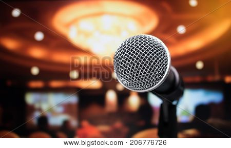 Microphone on abstract blurred of speech in seminar room or speaking conference hall light Event Background