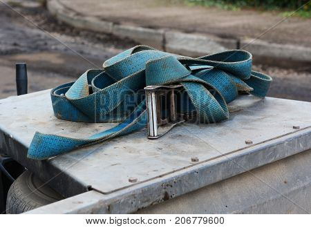 Blue Strap With A Metal Buckle On A Trailer