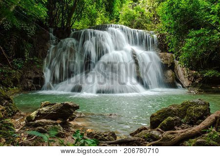 scenery view. beautiful waterfall among the tree in the deep forest are background. this image for nature landscape forest wild concept