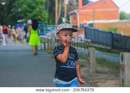 Zhytomyr Ukraine - July 12 2016: little boy eating something at street