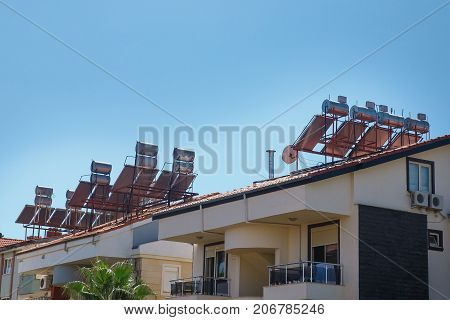 Contemporary hot water panels on a house, solar heater for green energy