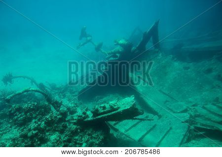 Metal bow of ship wreck on bottom of blue sea water