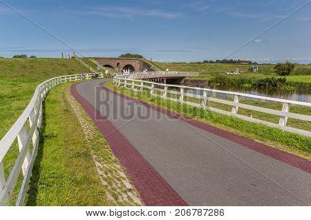 ADUARDERZIJL, NETHERLANDS - AUGUST 22, 2017: Road leading to the historic lock of Aduarderzijl, Netherlands