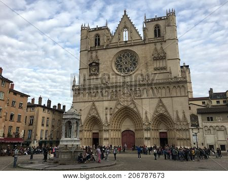 Lyon France, 1 October 2017: tourist in front of Roman Catholic Cathedral of Saint-Jean in Lyon France