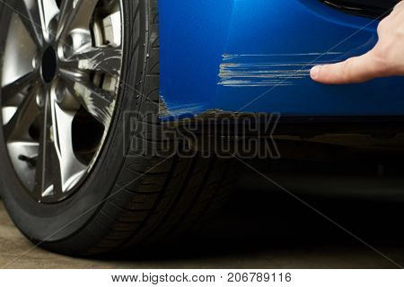 Paint scratch on car. Insurance company checking car damage