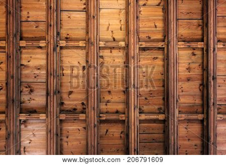 Dark old wooden ceiling with beams background or texture.