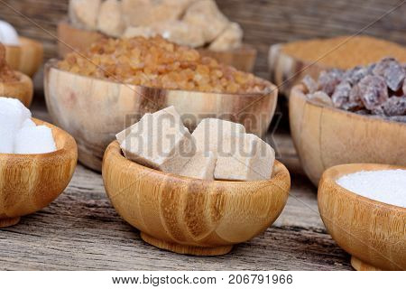 Variation sugar in a bowls on wooden table