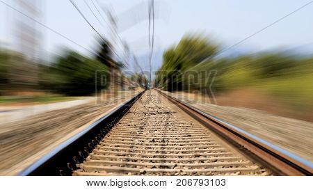 Railway station with motion blur effect. Industrial concept background. Transportation. Railroad travel railway tourism.