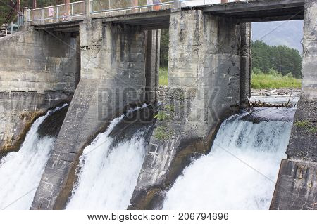 The old hydroelectric station. Russia Siberia Altai Chamal. discharge of water