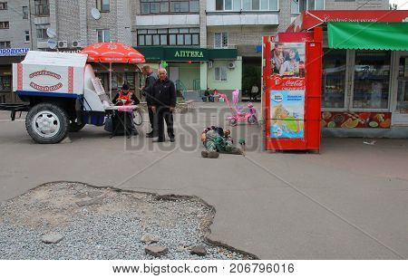 Zhytomyr Ukraine - September 23 2016: Drunk homeless man lying on the sidewalk at street