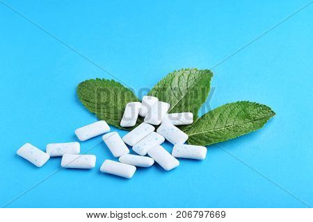 Chewing Gums With Mint Leafs On Blue Background