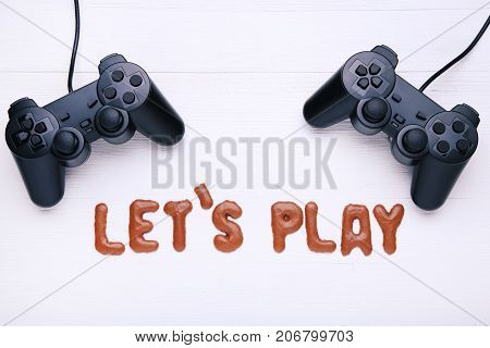 Let's Play written by chocolate cookies alphabet with joysticks