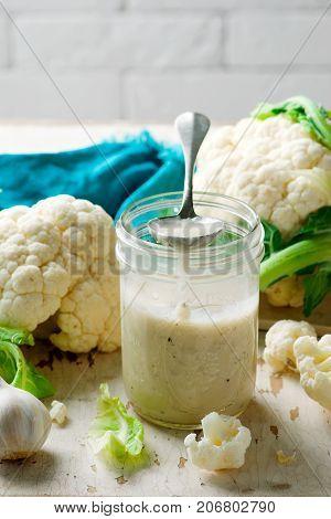 cauliflower alfredo sauce. style rustic. selective focus