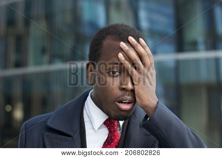 Close Up Portrait Of African American Businessman With Face Palm Gesture. Disappointed Stressed Out