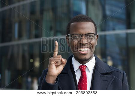 I Have An Idea! Handsome African American Businessman In Glasses Keeping Finger Pointed Upwards, Sho