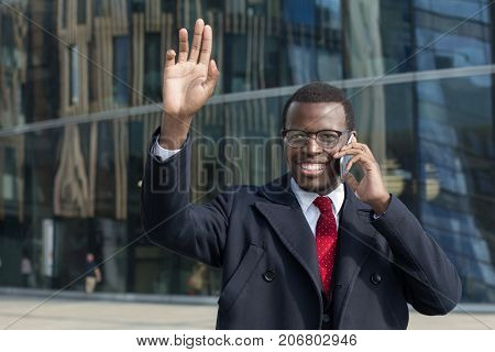 African American Businessman Greet And Say Hello To Colleague In City Outdoor.african American Busin