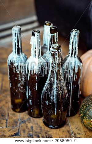 Wine bottle candlestick with melted wax. Halloween concept.