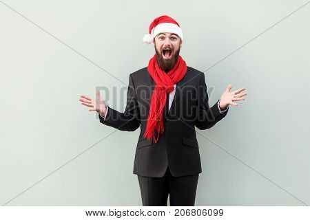 New Year Concept. Portrait Of  Businessman On New Year Hat, With Shocked Facial Expression. Looking