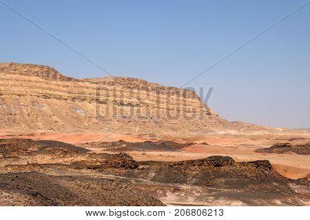 Arid volcanic landscape in Negev desert Israel.
