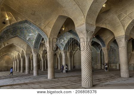 Fars Province Shiraz Iran - 19 april 2017: Monolithic pillars support arched vaults in prayer hall of Regents Mosque.