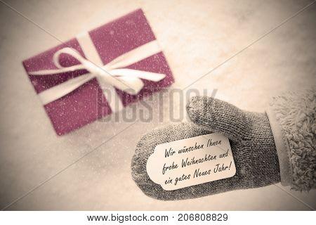 Glove With Label With German Text Wir Wuenschen Ihnen Frohe Weihnachten Und Ein Gutes Neues Jahr Means We Wish You A Merry Christmas And A Happy New Year. Pink Or Rose Gift With Instagram Filter