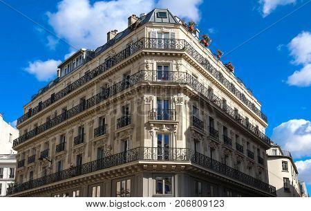 The typical facade of Parisian building, France.