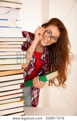 Attractive Beautiful Woman Geek In Study With Pile Of Books