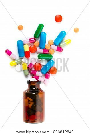 Colorful Pills Spilling Out Of A Toppled Bright Red Orange Pill Bottle