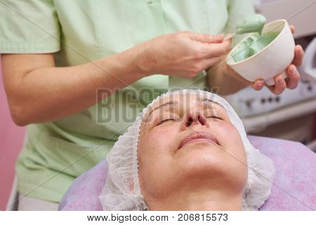 Adult female face, dermatology clinic. Person at the cosmetician.