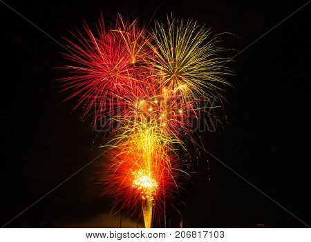 A brilliant fireworks celebration lights up the night sky creating a colorful moment and wonderful memories.