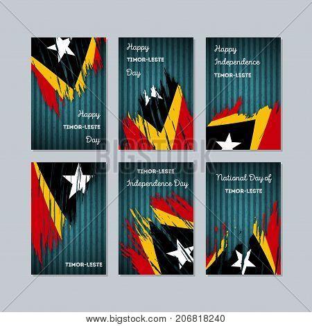 Timor-leste Patriotic Cards For National Day. Expressive Brush Stroke In National Flag Colors On Dar