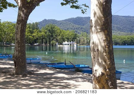 Bañola Lake With Boats In A Sunny Day, Spain