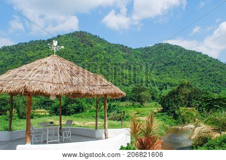 Cottage or hut with green mountain in nature
