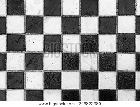 Black and white checked background tiles arranged in a pattern with space for text.