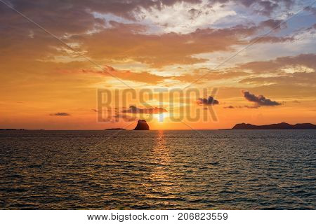 Beautiful natural landscape of colorful cloud sky and sun at sunset over the sea in Surat Thani province Thailand
