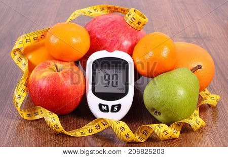 Glucose Meter With Tape Measure And Fresh Fruits, Diabetes, Healthy Nutrition And Slimming Concept