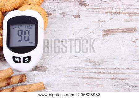 Glucose Meter For Checking Sugar Level And Cookies, Diabetes, Reduction Eating Sweets Concept, Copy