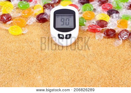 Glucose Meter For Checking Sugar Level, Candies And Granulated Brown Cane Sugar, Concept Of Diabetes