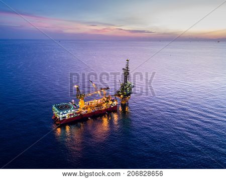 Aerial View of Tender Drilling Oil Rig (Barge Oil Rig) in The Middle of The Ocean at Surise Time