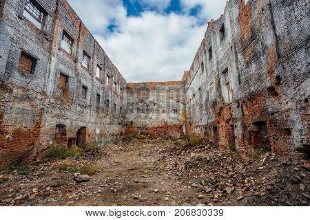 Ruined red brick industrial building. Abandoned and destroyed sugar factory in Novopokrovka, Tambov region