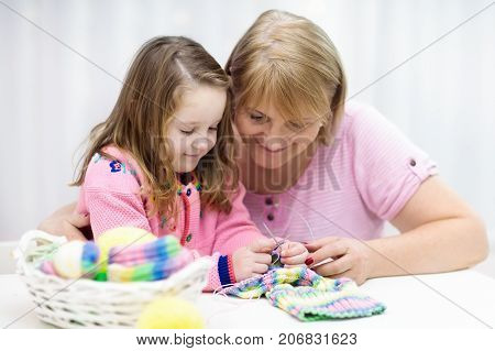 Mother And Child Knitting. Knit Wear. Crafts With Kids.