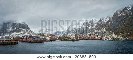 Panorama of traditional fishing village A on Lofoten Islands, Norway with red rorbu houses. With snow in winter