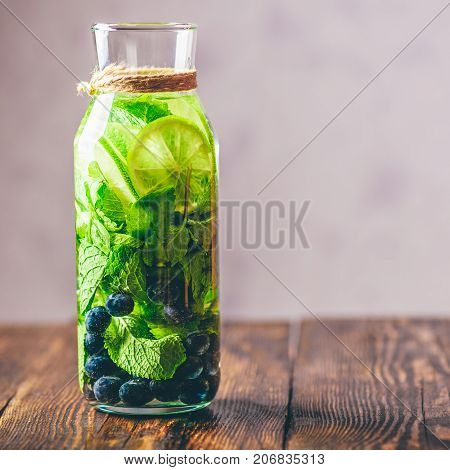 Water Infused with Lime Mint and Blueberry. Copy Space on the Right.