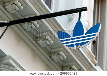 New York September 25 2017: Adidas logo is suspended above the entrance to their store in SoHo.