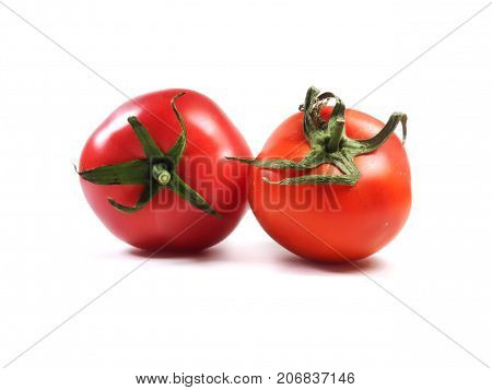 Isolate tomatoes. Tomatoes on a white background. Food, vegetable, red tomato.