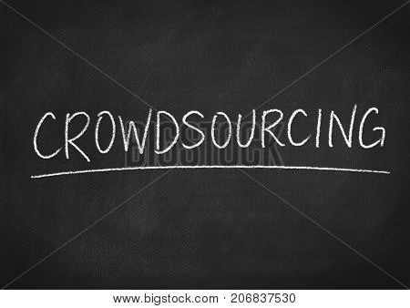 crowdsourcing concept word on a blackboard background