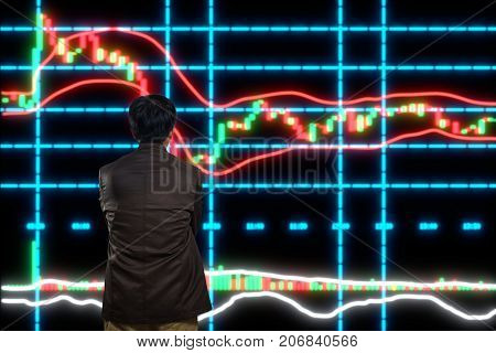 Asian Man Or Male Looking At Stock Trading Data Chart On Display Board