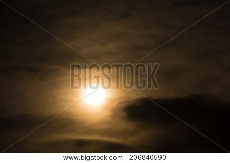 bright coloured Moon in the black sky. mystical light from the Moon in a black sky. full moon