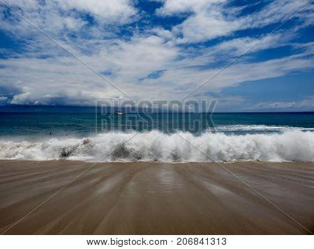 Crashing Waves with Boat and Neighboring Island in the Background. Kaanapali Beach Resort Area, Lahaina, Maui, Hawaii