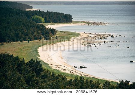 Overlook on rugged coastline and coniferous forest of Hiiumaa island Estonia